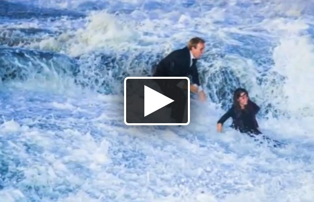 Huge wave knocks ruins marriage proposal